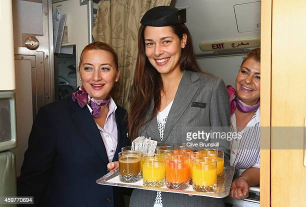 Ana Ivanovic of the Indian Aces takes on the roll of stewardess as she is about to serve drinks to the players on a private jet from Manila to...