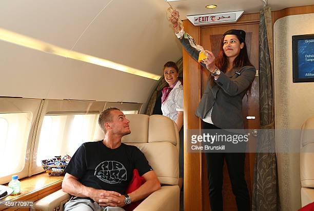 Ana Ivanovic of the Indian Aces takes on the roll of stewardess as she gives a safety demonstration during their flight on a private jet from Manila...