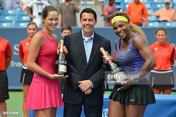 Ana Ivanovic Vince Cicero and Serena Williams celebrate with Moet Chandon the official champagne of the Western Southern Open following Williams'...