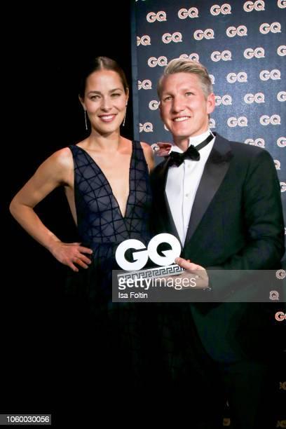 Ana IvanovicSchweinsteiger and her husband former German soccer player and award winner Bastian Schweinsteiger are seen on stage during the GQ Men of...
