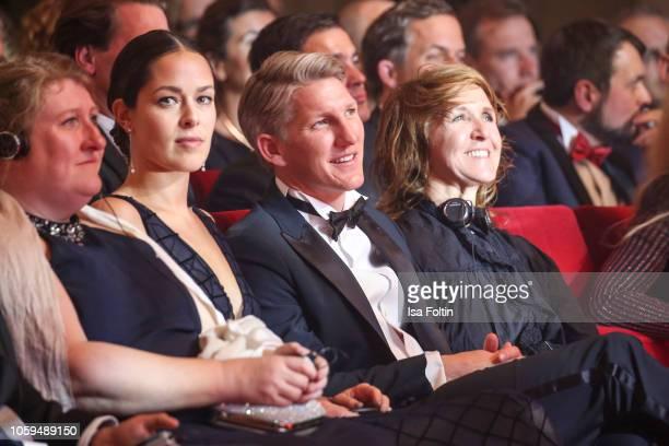 Ana IvanovicSchweinsteiger and her husband former German soccer player Bastian Schweinsteiger during the GQ Men of the Year Award show at Komische...