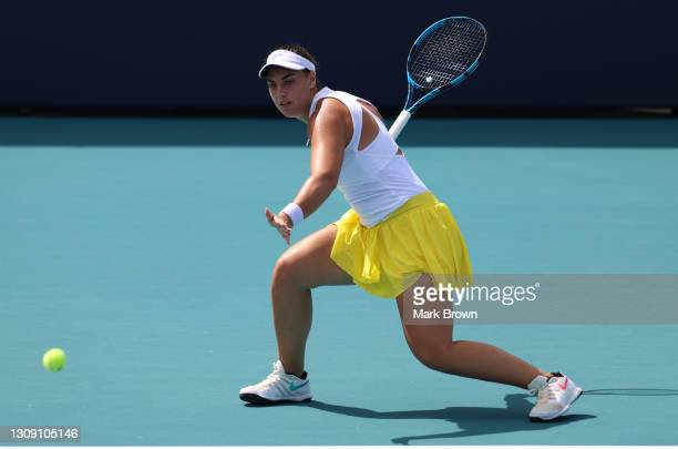 Ana Konjuh of Coatia returns a shot during her singles second round match against Madison Keys of the United States on Day 4 of the 2021 Miami Open...