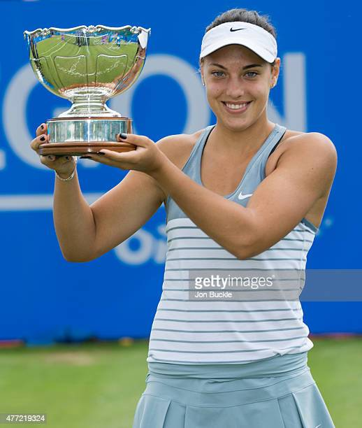 Ana Konjuh of Croatia celebrates winning the Aegon Open Nottingham against Monica Niculescu of Romania with the Elena Baltacha Trophy on day eight of...
