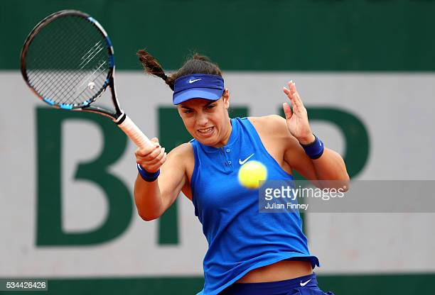 Ana Konjuh of Croatia hits a forehand during the Ladies Singles second round match against Dominika Cibulkova of Slovakia on day five of the 2016...