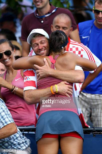 Ana Konjuh of Croatia hugs a member of her team after winning her junior girls' singles final match against Tornado Alicia Black of the United States...
