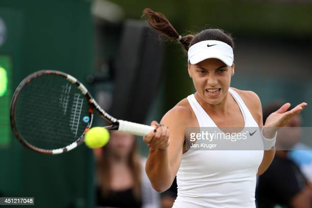 Ana Konjuh of Croatia in action during her Ladies' Singles second round match against Yanina Wickmayer of Belgium on day three of the Wimbledon Lawn...