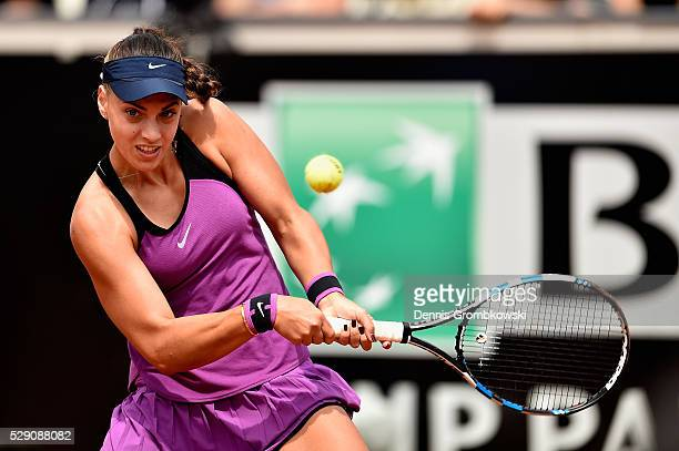 Ana Konjuh of Croatia plays a backhand in her match against Heather Watson of Great Britain on Day One of The Internazionali BNL d'Italia 2016 on May...