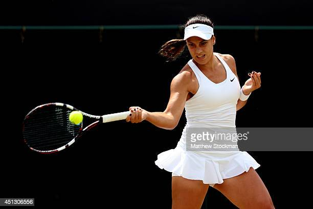 Ana Konjuh of Croatia plays a forehand return during the Ladies' Singles third round match against Caroline Wozniacki of Denmark on day five of the...