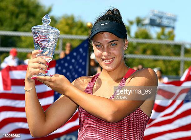 Ana Konjuh of Croatia poses with her trophy after winning her junior girls' singles final match against Tornado Alicia Black of the United States of...