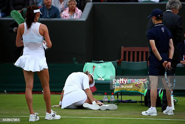 Ana Konjuh of Croatia reacts after injuring her ankle during the Ladies Singles second round match against Agnieszka Radawanska of Poland on day four...