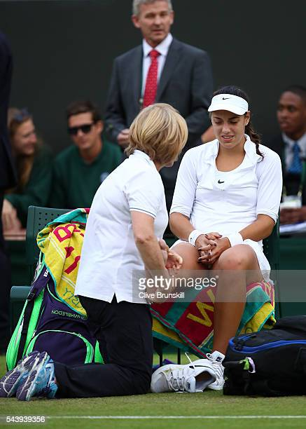 Ana Konjuh of Croatia receives treatment on her ankle during the Ladies Singles second round match against Agnieszka Radawanska of Poland on day four...