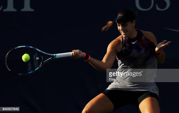 Ana Konjuh of Croatia returns a shot during her first round Women's Singles match against Ashleigh Barty of Australia on Day One of the 2017 US Open...