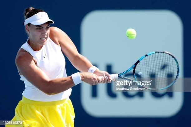 Ana Konjuh of Croatia returns a shot to Anastasija Sevastova of Latvia during the Miami Open at Hard Rock Stadium on March 29, 2021 in Miami Gardens,...