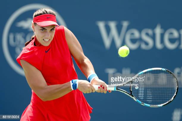 Ana Konjuh of Croatia returns a shot to Dominika Cibulkova of Slovakia during day 4 of the Western Southern Open at the Lindner Family Tennis Center...