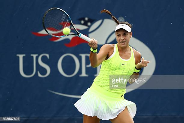 Ana Konjuh of Croatia returns a shot to Kurumi Nara of Japan during her second round Women's Singles match on Day Four of the 2016 US Open at the...