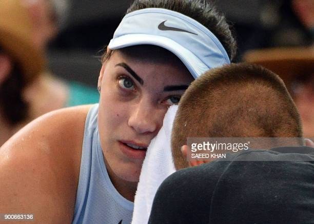 Ana Konjuh of Croatia talks to her coach between sets while playing against Elina Svitolina of Ukraine during their round of 16 match at the Brisbane...