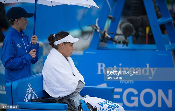Ana Konjuh of Croatia waits for the rain to clear during her match against Alison Riske of USA on day seven of the WTA Aegon Open Nottingham at...