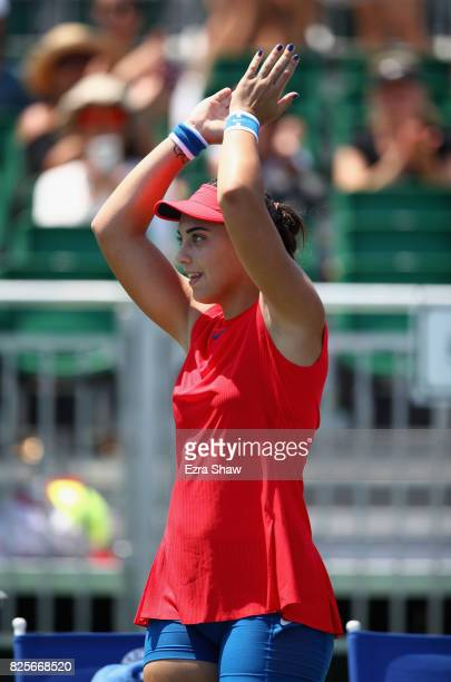 Ana Konjuh of Croatia waves to the crowd after beating Natalia Vikhlyantseva of Russia during Day 3 of the Bank of the West Classic at Stanford...