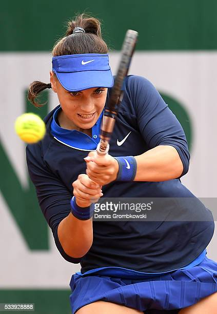 Ana Konjuh of Croatis plays a backhand during the Women's Singles first round match against Arina Rodionova of Australia on day three of the 2016...