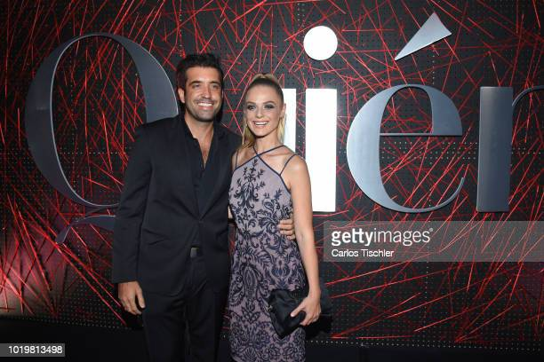 Ana Layevska and guest pose for photos during the red carpet for 'Quien' magazine's 18th anniversary at Foro Masaryk on August 15 2018 in Mexico City...