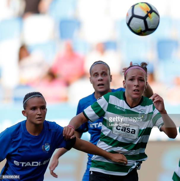 Ana Leite of Sporting CP competes for the ball with Edina FaradiSzabo of MTK Hungaria FC and Dora Papp of MTK Hungaria FC during the UEFA Women's...