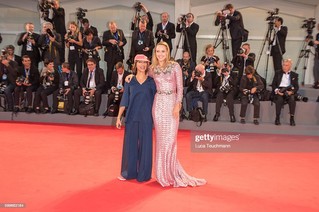 Ana Lily Amirpour and Suki Waterhouse attend the premiere of 'The Bad Batch' during the 73rd Venice Film Festival at Sala Grande on September 6, 2016 in Venice, Italy.