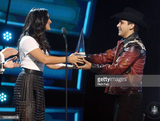 Ana Lorena Sanchez presents the Favorite Regional Mexican Album award for 'Me Deje Llevar' to Christian Nodal onstage during the 2018 Latin American...