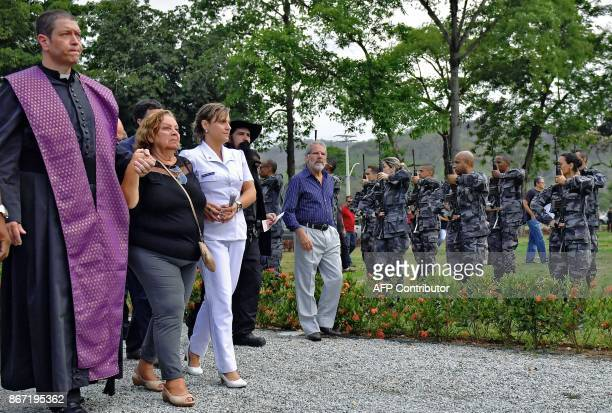 Ana Lucia Teixeira mother of deceased Police Colonel Luis Gustavo Teixeira is escorted to his grave during his funeral in Sulacap in western Rio de...