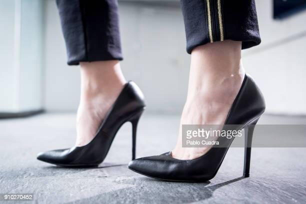 Ana Manrique wears Mas34 shoes, TCN trousers, Elisabetta Franchi handbag, H&M cap and Gucci belt at Ifema during Mercedes Benz Fashion Week Madrid...