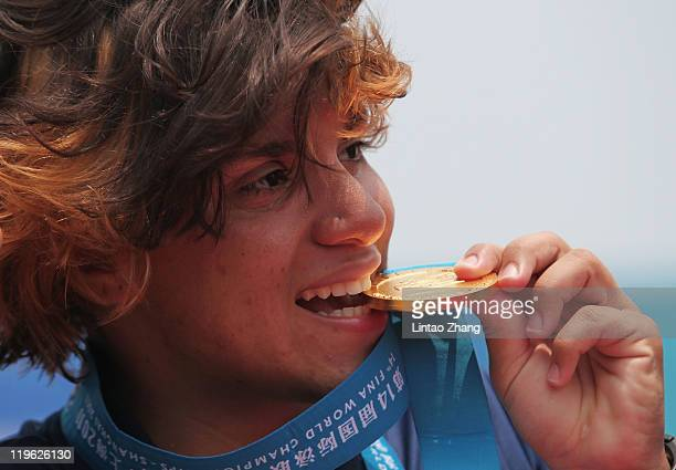 Ana Marcela Cunha of Brazil attends the victory ceremony for the Women's Open Water 25km during Day Eight of the 14th FINA World Championships at the...