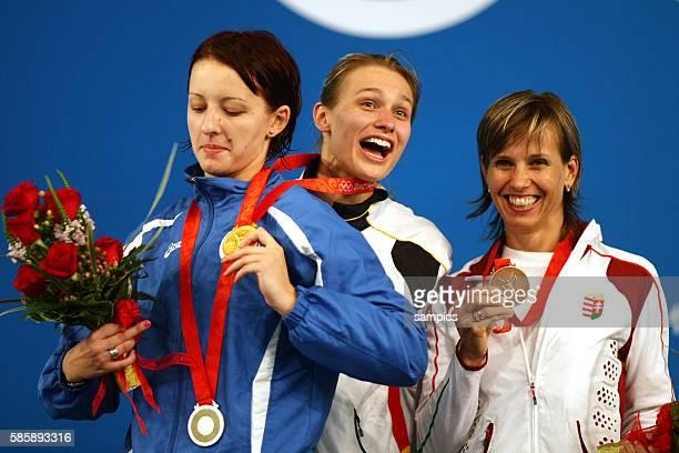 Ana Maria Branza Britta Heidemann and Ildiko Mincza Nebald on the podium