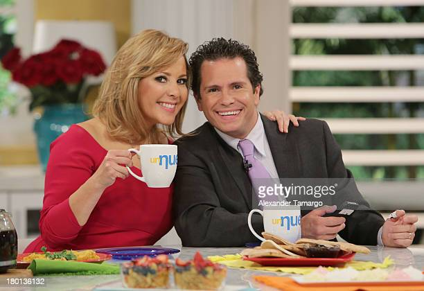 Ana Maria Canseco and Diego Schoening are seen on the set of Telemundo's Un Nuevo Dia at Telemundo Studio on September 9 2013 in Miami Florida
