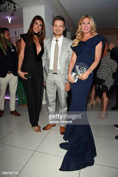 Ana Maria Folostina Jeremy Renner and Hofit Golan attend 62 Taormina Film Fest Gala Dinner Day 4 on June 14 2016 in Taormina Italy