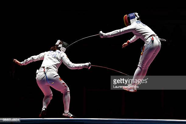 Ana Maria Popescu of Romania competes against Anqi Xu of China during the Women's Epee Team Gold Medal Match bout on Day 6 of the 2016 Rio Olympics...