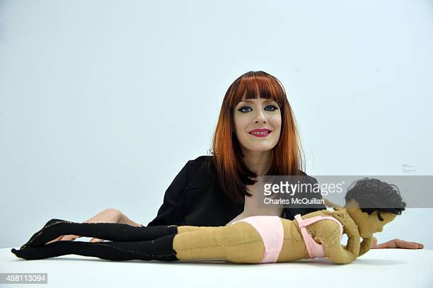 Ana Matronic looks at a work by Darek Fortas at the announcement of the MAC International arts prize on October 30 2014 in Belfast Northern Ireland...