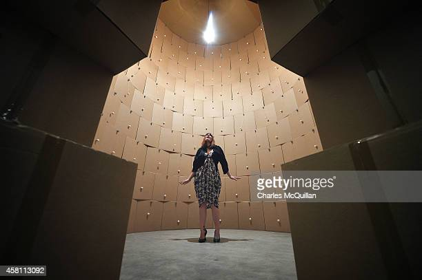 Ana Matronic pictured inside the sound installation by the artist Zimoun which consists of 186 prepared dcmotors cotton balls and stacked cardboard...