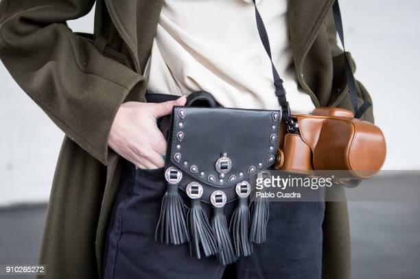 Ana Moya wears Jefrey Campbell shoes, Pull&Bear trousers, Asos belt, H&M coat and Zara shirt at Ifema during Mercedes Benz Fashion Week Madrid Autumn...