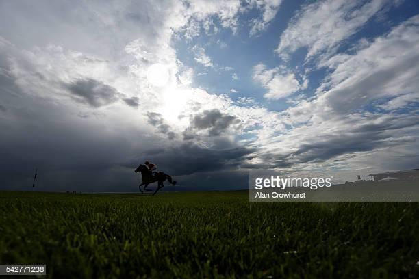 Ana O'Brien riding Arya Tara make their way to the start at Curragh racecourse on June 24 2016 in Kildare Ireland