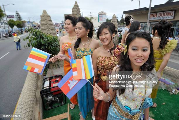 BEACH CALIF USA Ana Ong right joins other girls atop the CAMCC float in the 7th Annual Cambodian New Year Parade in the Cambodian Town neighborhood...