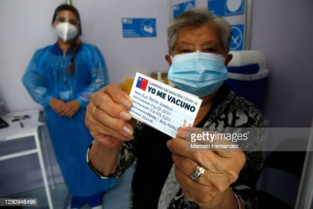 Ana Padilla, 92 years old, shows a vaccination card after receiving a dose of the Sinovac Biotech Ltd vaccine during the first day of the mass...