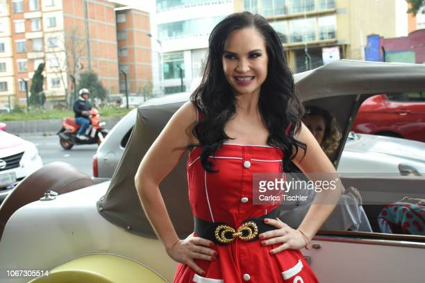 Ana Patricia Rojo poses for photos in front of a classic car during a press conference to present the play 'Divinas' at Be Bops Dinner on November 13...