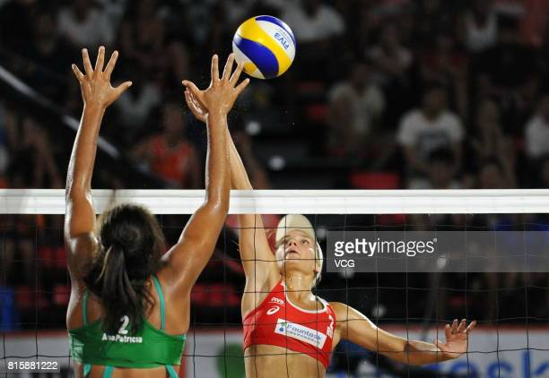 Ana Patricia Silva Ramos of Brazil compete in the women's final match against Svetlana Kholomina of Russia during the 2017 FIVB Beach Volleyball U21...