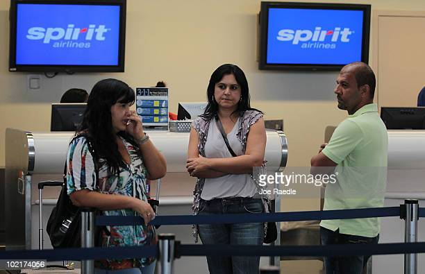 Ana Paula Andrade Cassia Moreira and Fernando Braga travelling from Brazil to Las Vegas wait in line to speak with a Spirit Airlines Inc employee at...