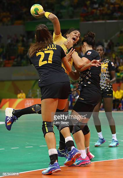Ana Paula Belo of Brazil is challenged by Lara Ortega Gonzalez of Spain during the Womens Preliminary Group A match between Brazil and Spain at...