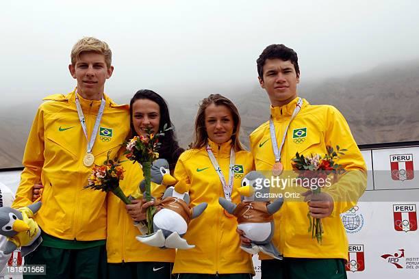 Ana Paula Casetta and Andre Gohr of Brazil Renata Da Silva and Rodrigo Do Santo of Brazil pose for a photo after winning the Mountain Bike Mixed Team...