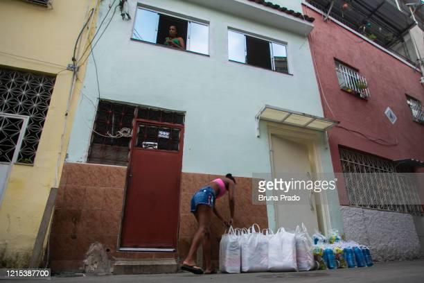 Ana Paula Oliveira founder of Mothers of Manguinhos mother of a child victim of violence resident of the Favela de Manguinhos arranges the donations...