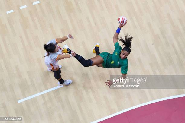 Ana Paula Rodrigues Belo of Team Brazil shoots at goal whilst Lara Gonzalez Ortega of Team Spain defends during the Women's Preliminary Round Group B...