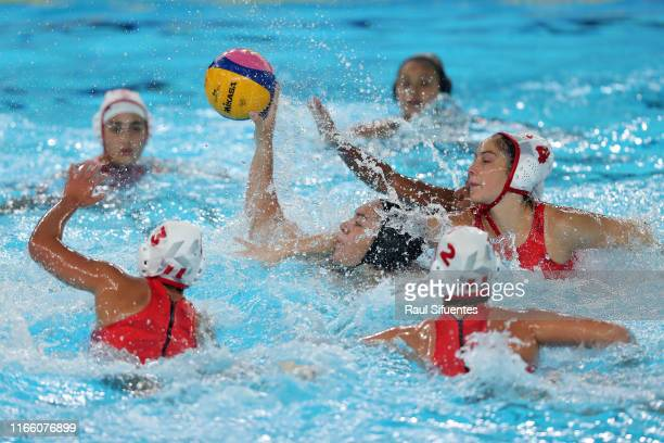 Ana Ramirez Hinojosa of Mexico is blocked by Alisa Lopez of Peru during Women's Water polo Preliminary Group B match between Mexico and Peru at...