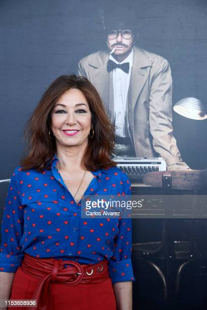 Ana Rosa Quintana poses in front of her photograph where she appears as a man during 'Protagonistas del Año' opening exhibition organized by...