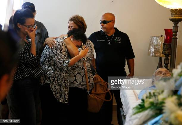 Ana Ruiz is consoled by a loved one as funeral directors prepare to close her husband Victor Ruiz Ramos' casket in Corozal Puerto Rico on Oct 02 2017...